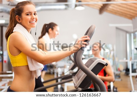 Beautiful woman training in a gym - stock photo