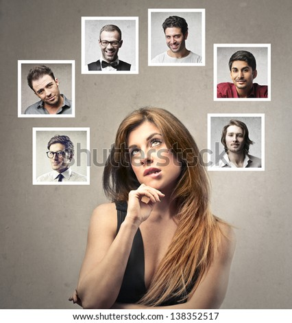 beautiful woman undecided about which man to choose - stock photo