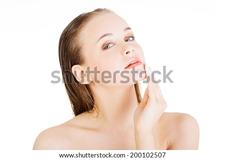 Beautiful woman using cotton pad , isolated on white - stock photo