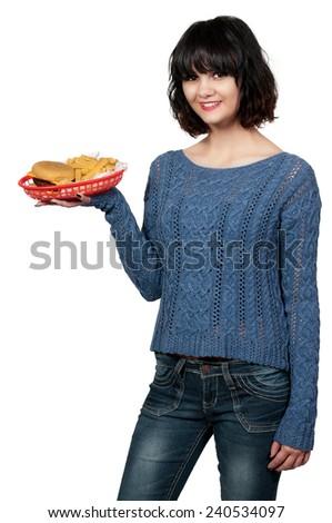 Beautiful woman waitress serving hamburger and fries - stock photo