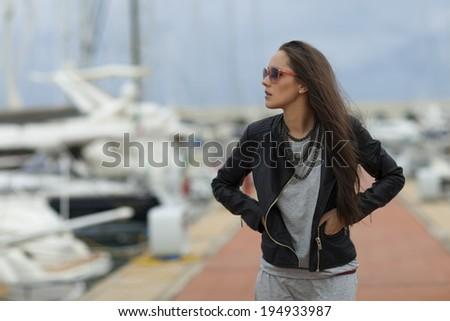 Beautiful woman walking in marina, Italy - stock photo