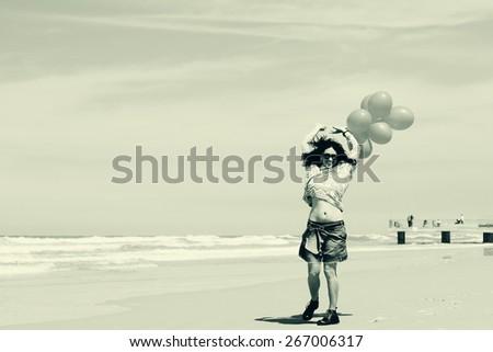 beautiful woman walking on seaside - stock photo