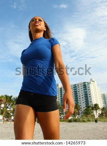 Beautiful Woman Walking On The Beach - stock photo