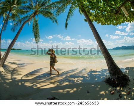 Beautiful woman walking  on the beach in Koh Samui Thailand. - stock photo