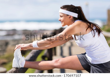 beautiful woman warming up before exercise - stock photo
