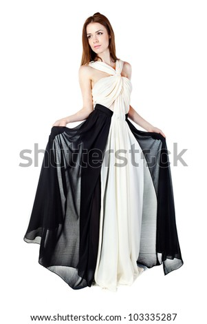 Beautiful woman wearing an elegant dress, over white background posing in studio.Fashion photo. - stock photo