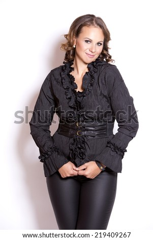 beautiful woman wearing black upscale outfit on white background - stock photo