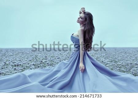 Beautiful woman wearing blue dress - stock photo