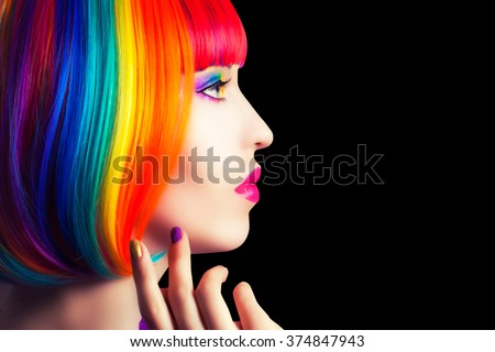 beautiful woman wearing colorful wig and showing colorful nails against black background - stock photo