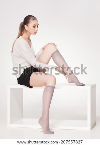 beautiful woman wearing knee lycra socks - full body  - stock photo