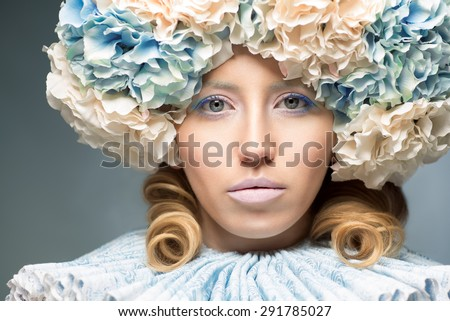beautiful woman wearing lace collar and flower headpiece - stock photo
