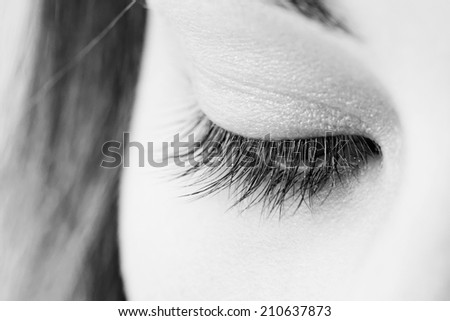 beautiful woman wearing makeup for eyes (monchrome image) - stock photo