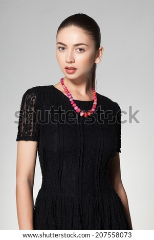 beautiful woman wearing marble necklace on grey background - stock photo