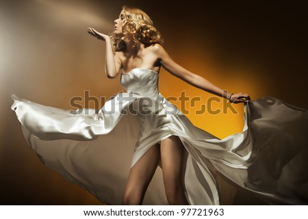 Beautiful woman wearing white dress - stock photo