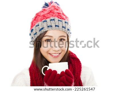 beautiful woman wearing winter clothing and holding coffee cup - stock photo
