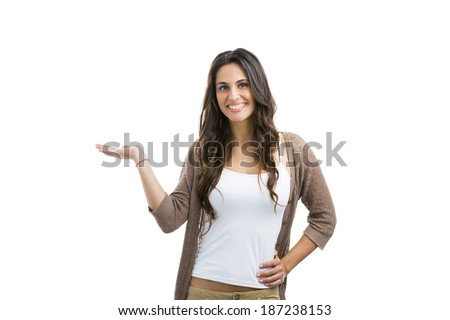 Beautiful woman whowing something on her hand, with copyspace for the designer - stock photo