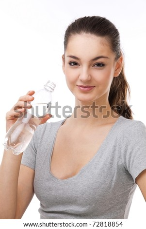 Beautiful woman with a bottle of fresh water. On a white background. - stock photo