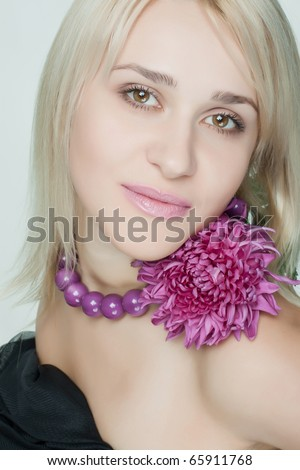 beautiful woman with a flower on a light background - stock photo