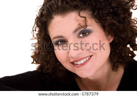 Beautiful woman with a gorgeous smile and curly hair - stock photo