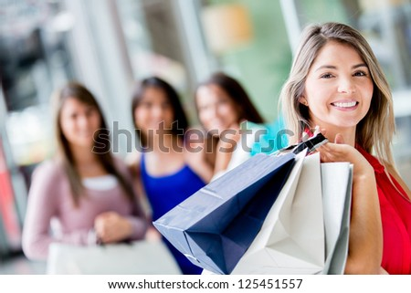 Beautiful woman with a group of shopping girls - stock photo