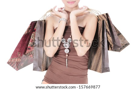 Beautiful woman with a lot of shopping bags, isolated on white background - stock photo