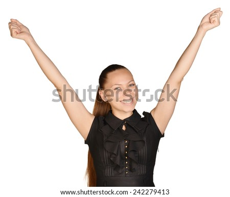 beautiful woman with a smile rejoices his success raising both hands up - stock photo
