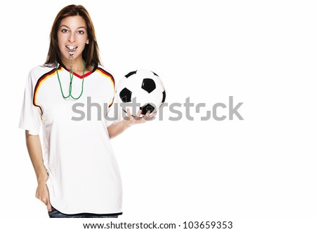 beautiful woman with a whistle wearing football shirt and holding football on white background - stock photo