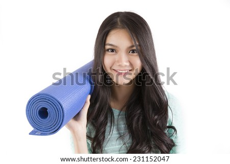 Beautiful woman with a yoga mat on white background - stock photo
