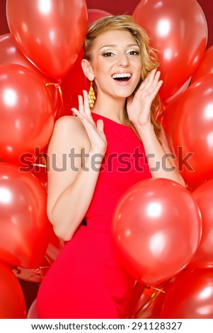 Beautiful woman with balloons - stock photo