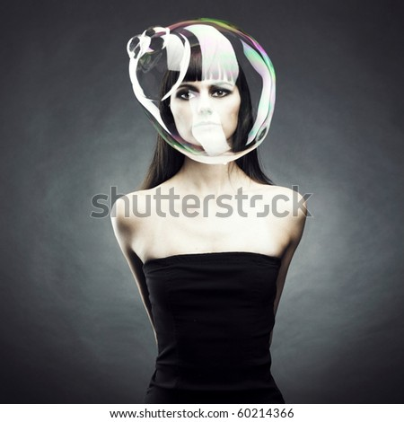 Beautiful woman with big soap bubble. Conceptual photo - stock photo