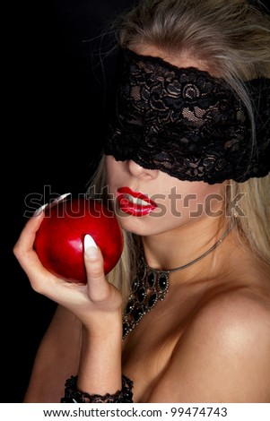 Beautiful Woman with Black lace eating Red apple isolated on black - stock photo