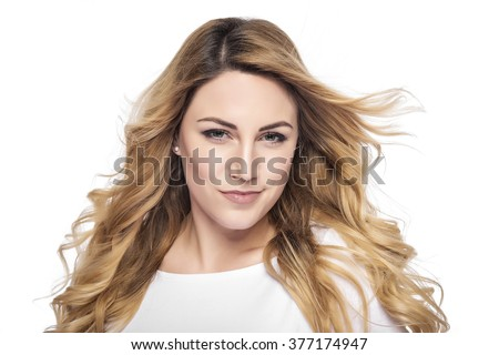 Beautiful woman with blond hair. Attractive model posing at studio.  - stock photo