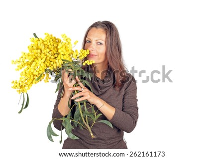 Beautiful woman with blossoming mimosa - stock photo