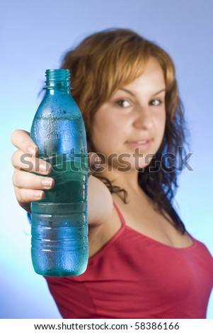 beautiful woman with bottle of water over blue - stock photo