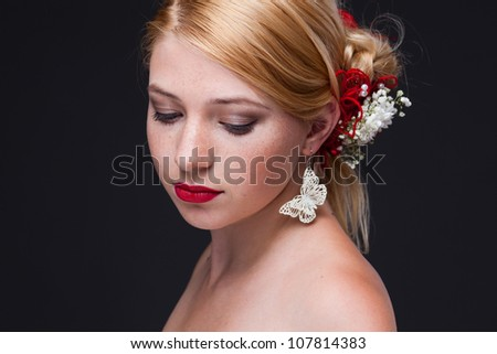 beautiful woman with bright make-up on black background - stock photo