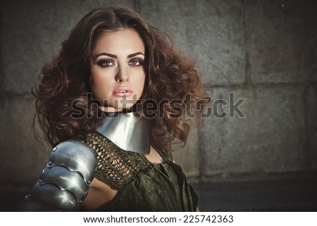 Beautiful woman with brown hair in fashion military clothing - stock photo