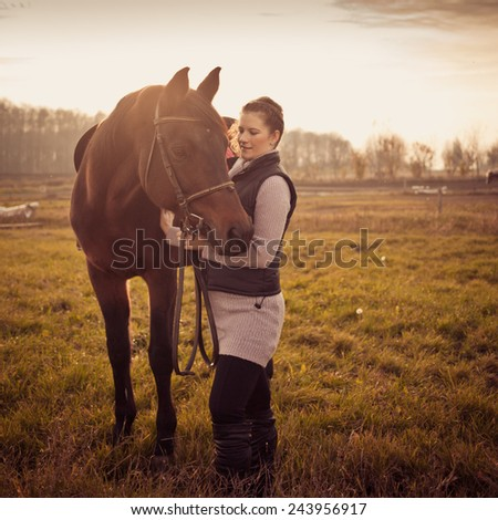 beautiful woman with brown horse - stock photo