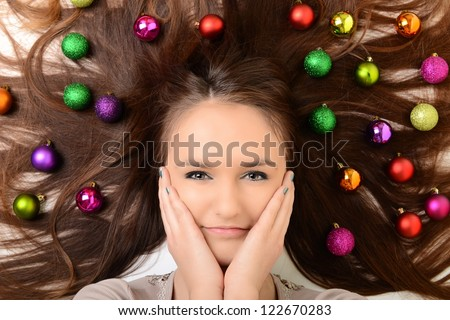 Beautiful woman with christmas decorations - stock photo