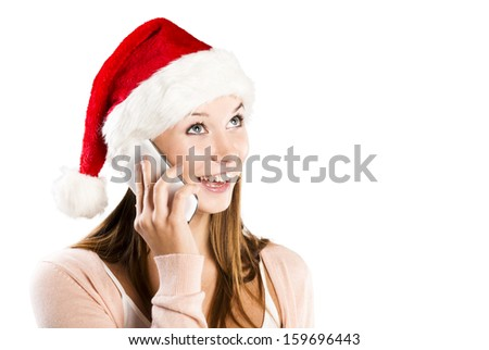 Beautiful woman with christmas hat is posing in studio. Isolated on white background. - stock photo