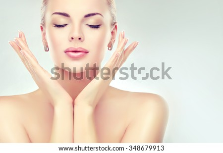 Beautiful  Woman with Clean Fresh Skin close up . Skin care face . Cosmetology - stock photo