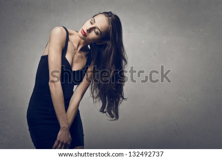 beautiful woman with closed eyes on gray background - stock photo