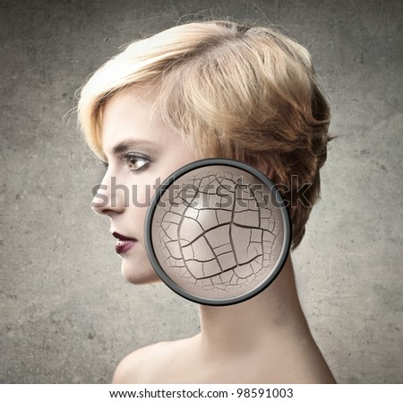 Beautiful woman with closeup of her dry skin - stock photo