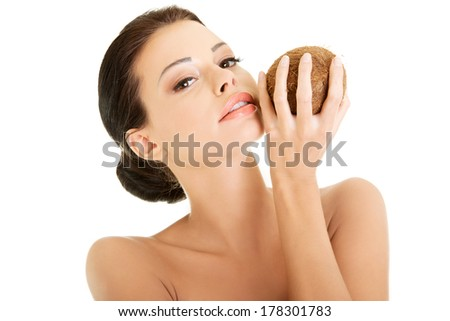 Beautiful woman with coconut in hands over white background  - stock photo