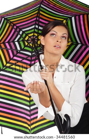 beautiful woman with colorful umbrella on white background - stock photo