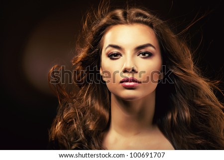 beautiful woman with curly hair in dark - stock photo