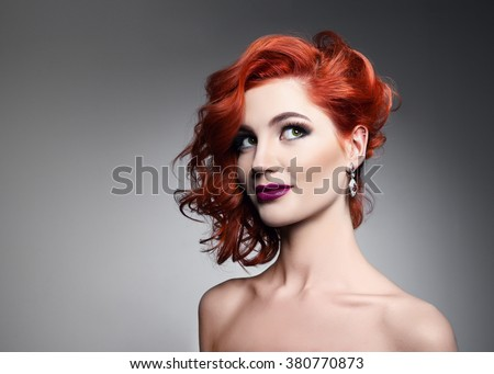 Beautiful woman with curly hairstyle - stock photo