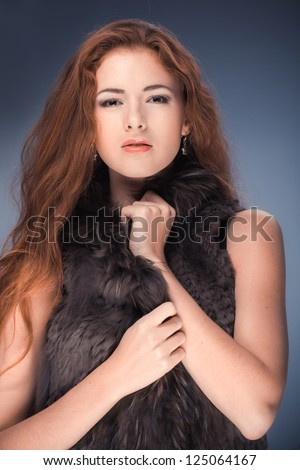 Beautiful woman with curly long hair - stock photo