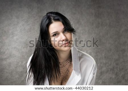 Beautiful woman with dark hair. Photo in studio - stock photo