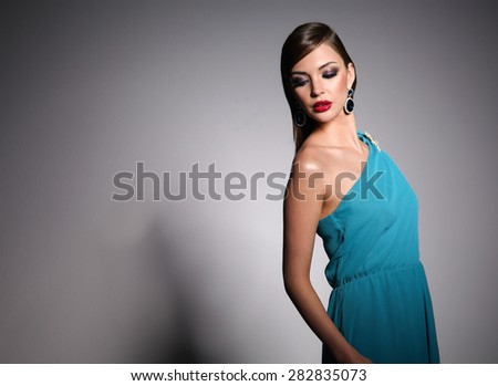 Beautiful woman with evening make-up - stock photo