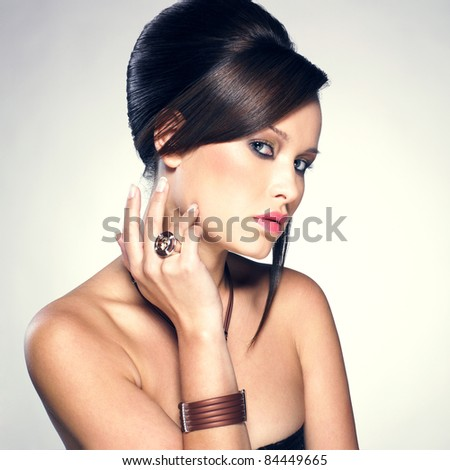 Beautiful woman with evening make-up and hairstyle. Jewelry and Beauty. Fashion photo - stock photo